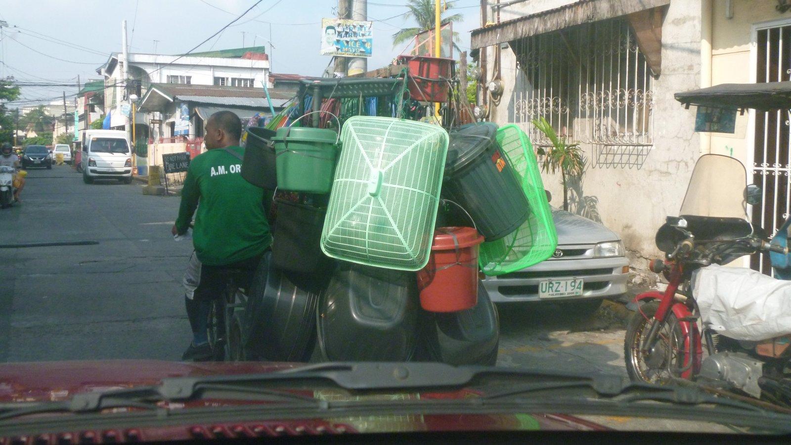 Man-taking-goods-to-sell-on-pedicab